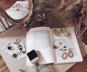 books, details, and jewelry image