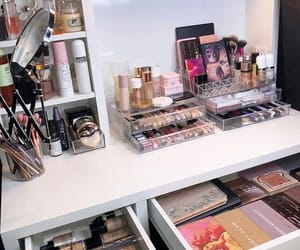 vanity, makeup collection, and beauty room image