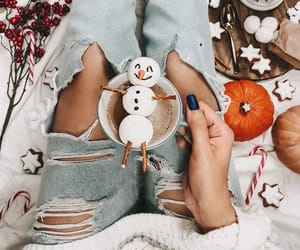 candy, hand, and merry christmas image