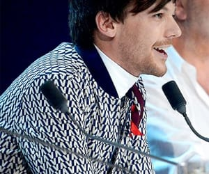 louis tomlinson, judge, and x factor image