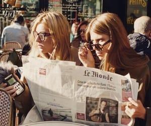 girl and newspaper image