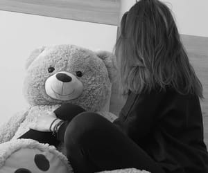 black and white and teddy bear image