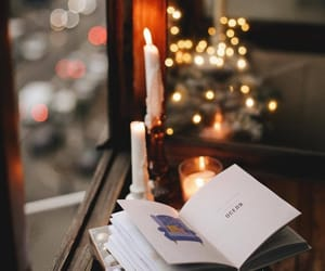 candle, book, and light image
