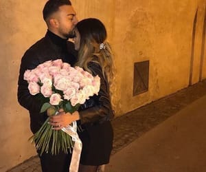 couple, kiss, and flowers image