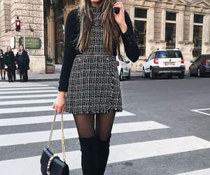 black boots, black top, and dress image
