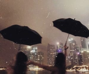 city, rain, and friends image