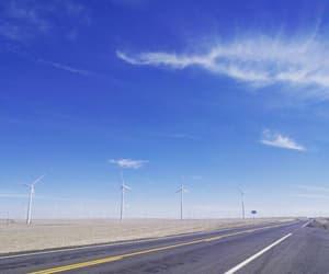 asphalt, blue sky, and clouds image