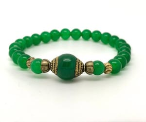 4, yellow jewelry, and green jewelry image