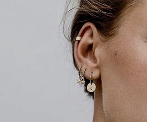 piercing, earrings, and gold image