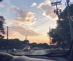 car, sky, and small town image