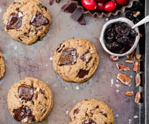These Cranberry Pecan Chocolate Chip Cookies are gooey in the middle with perfectly crispy edges. Think: your favorite chocolate chip cookie, dressed up with dried cranberries and toasty pecans. I recommend devouring one of these gluten-free, paleo, and v