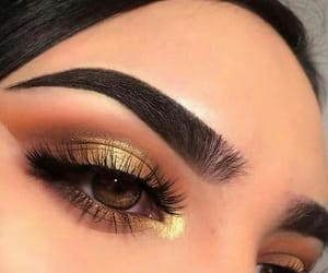 makeup, brows, and gold eyeshadow image