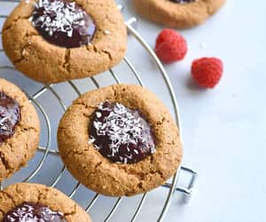 Paleo Raspberry Coconut Thumbprint Cookies! No one will guess these easy to bake coconut and nut butter cookies made with raspberry chia jam are grain free!