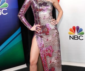 Miley dresses up nicely for the black  carpet.