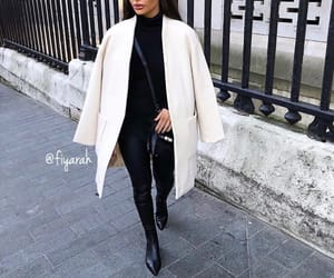 brune brunette, boots all black, and long white coat image