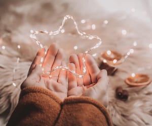 christmas, star, and hand image