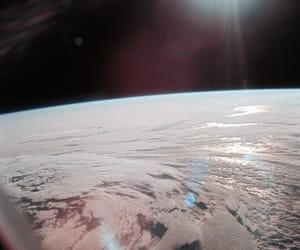 space, earth, and clouds image