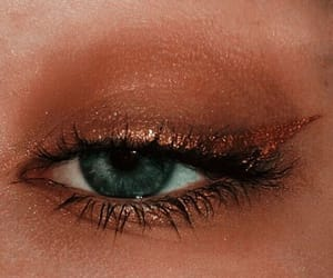 Gold liner, eyeliner, black mascara, green eyes, nude eyeshadow