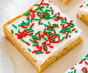 Snickerdoodle Bars with Cream Cheese Frosting -  Snickerdoodle bars are so much FASTER AND EASIER than making snickerdoodle cookies!! The sprinkles and tangy cream cheese frosting will put everyone in the holiday spirit!!