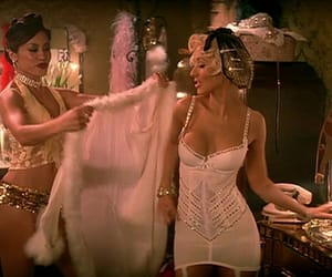 2006, feathers, and music video image