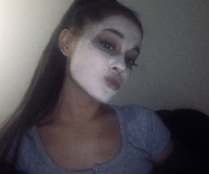 Even with a mask she still is cute