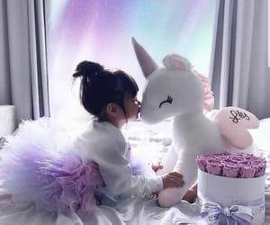 girl, unicorn, and baby image