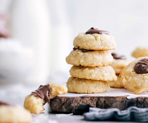 These cookies are the ultimate combination of macaroons and shortbread formed into a delicious thumbprint cookie and filled with nutella!