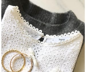 eyelet, jewelry, and wool sweater image