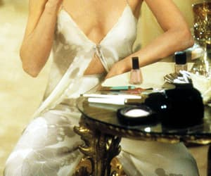 michelle pfeiffer, scarface, and cigarette image