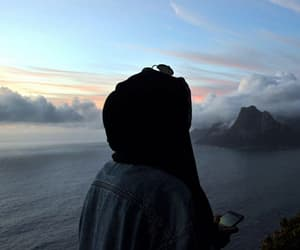 hijab and clouds image