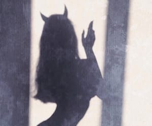 Devil, girl, and shadow image
