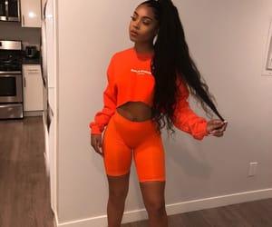 makeup, biker shorts, and orange image
