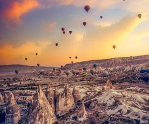 cappadocia, hot air balloon, and landscape image