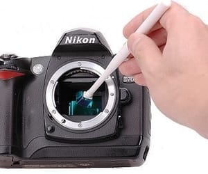 click here, dust in camera lens, and learn more image