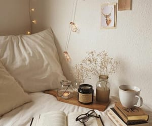bed, bedding, and book image