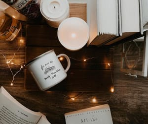book, candle, and lights image