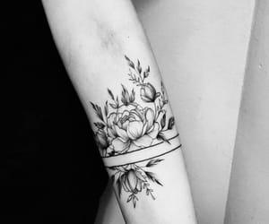 tattoo, flowers, and arm tattoo image
