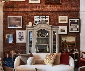 armoire, wall art, and living room image