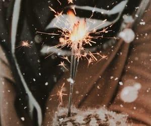 christmas, fire, and salute image
