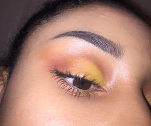 brown eyes, eyeliner, and yellow eyeshadow image
