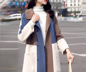 outerwear, winter coat, and fashion coat image