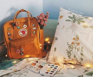 flowers, yellow, and backpack image