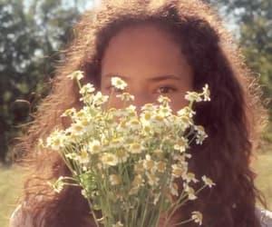 daisy, gif, and perfume ad image