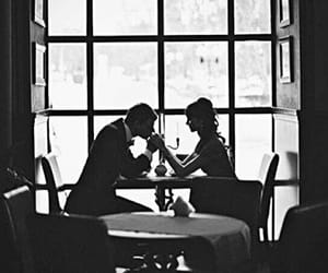 black and white, restaurant, and hand kissing image