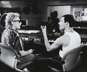 Freddie Mercury, roger taylor, and Queen image