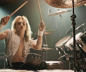 Queen, ben hardy, and drums image