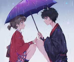 sad couple with umbrella image
