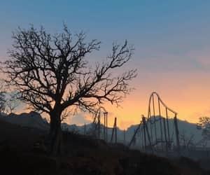 amusement park, wasteland, and orange sky image