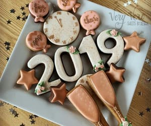 Cookies, midnight, and happy new years image