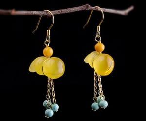 ear plugs, fashion, and yellow image